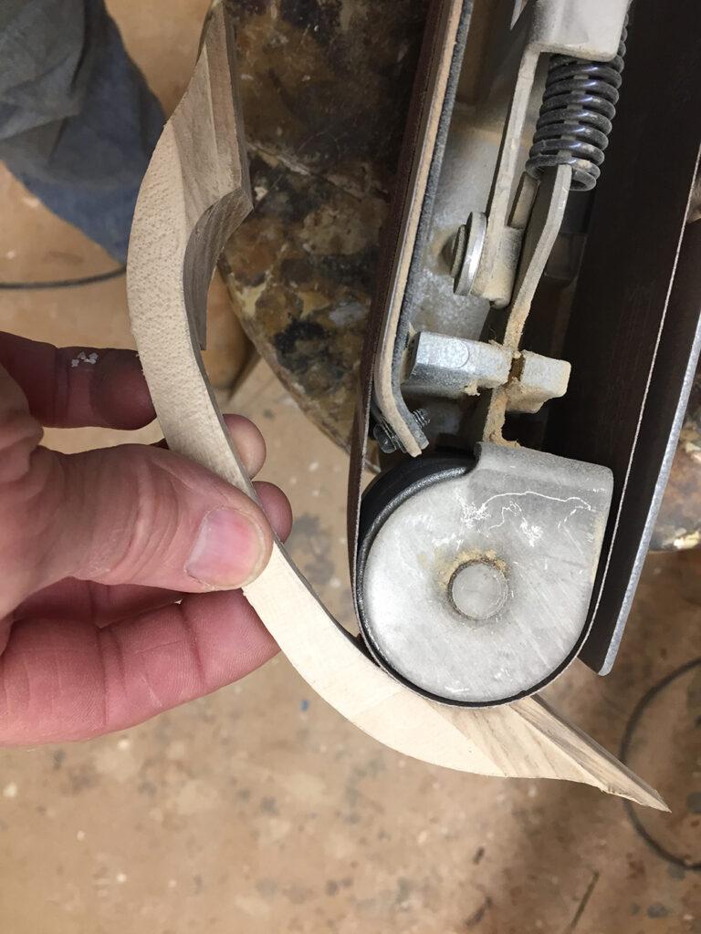 Belt sanding handle detail photo.