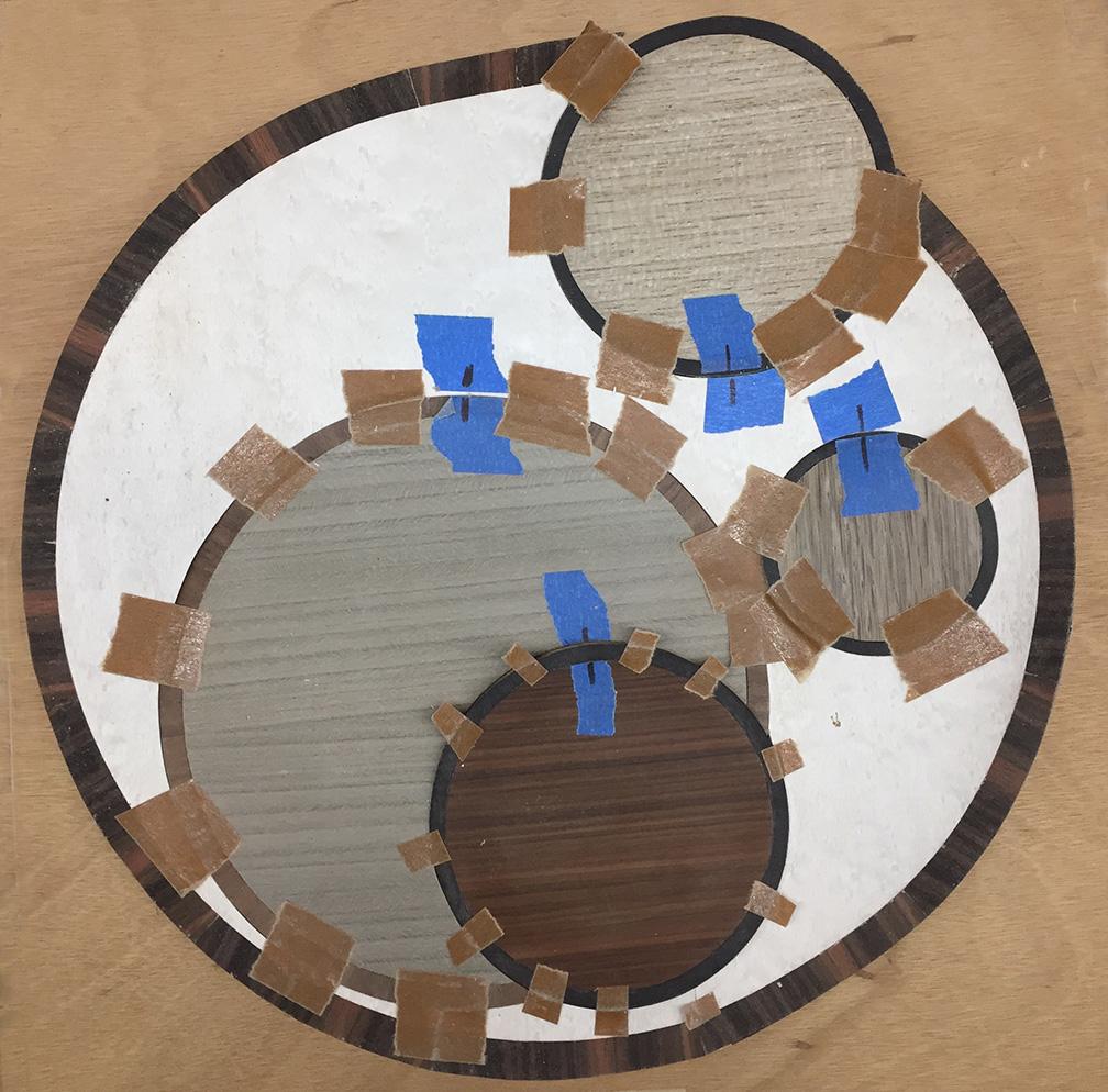 Veneer disks taped in place.